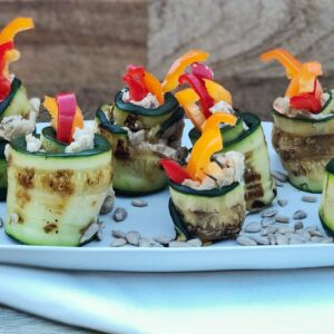 Vegan courgette rolls stuffed with sunflower seed hummous