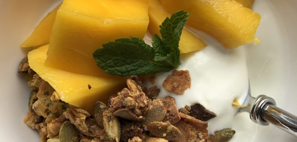 Homemade healthy granola with yoghurt and mango